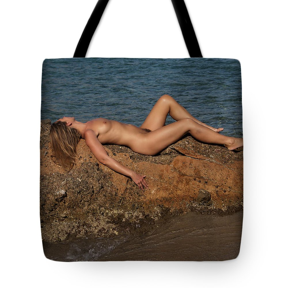 Nude Photography Tote Bag featuring the photograph On The Rocks by Manolis Tsantakis