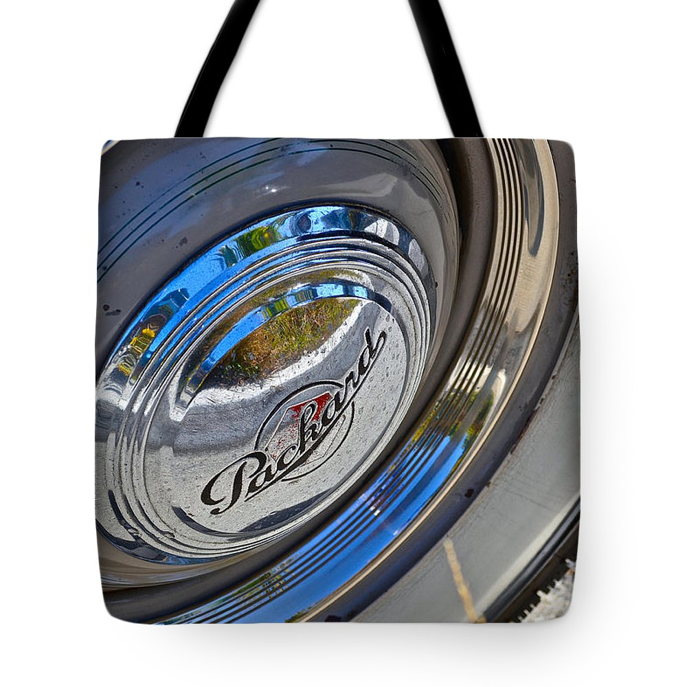 Vintage Cars Tote Bag featuring the photograph 1940 Packard Hubcap by Bill Owen