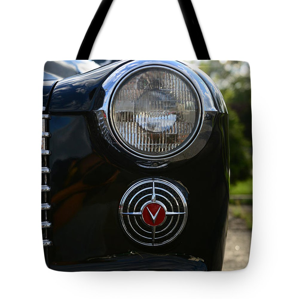 1941 Cadillac Headlight Tote Bag featuring the photograph 1941 Cadillac Headlight by Paul Ward