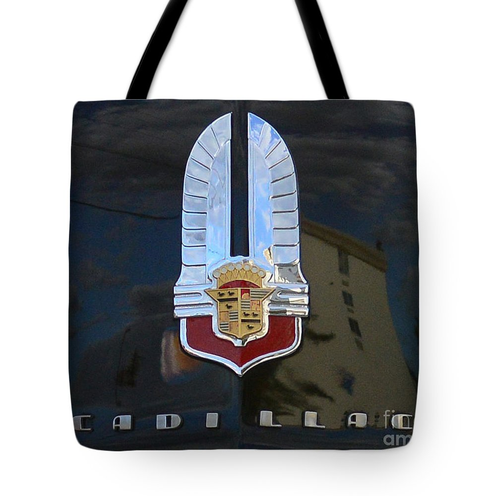 1941 Cadillac Hood Insignia Tote Bag featuring the photograph 1941 Cadillac Hood Insignia by Paul Ward