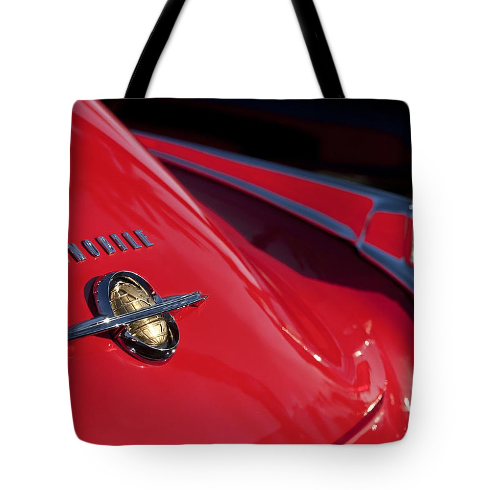 1950 Oldsmobile Rocket 88 Tote Bag featuring the photograph 1950 Oldsmobile Rocket 88 Rear Emblem And Taillight by Jill Reger