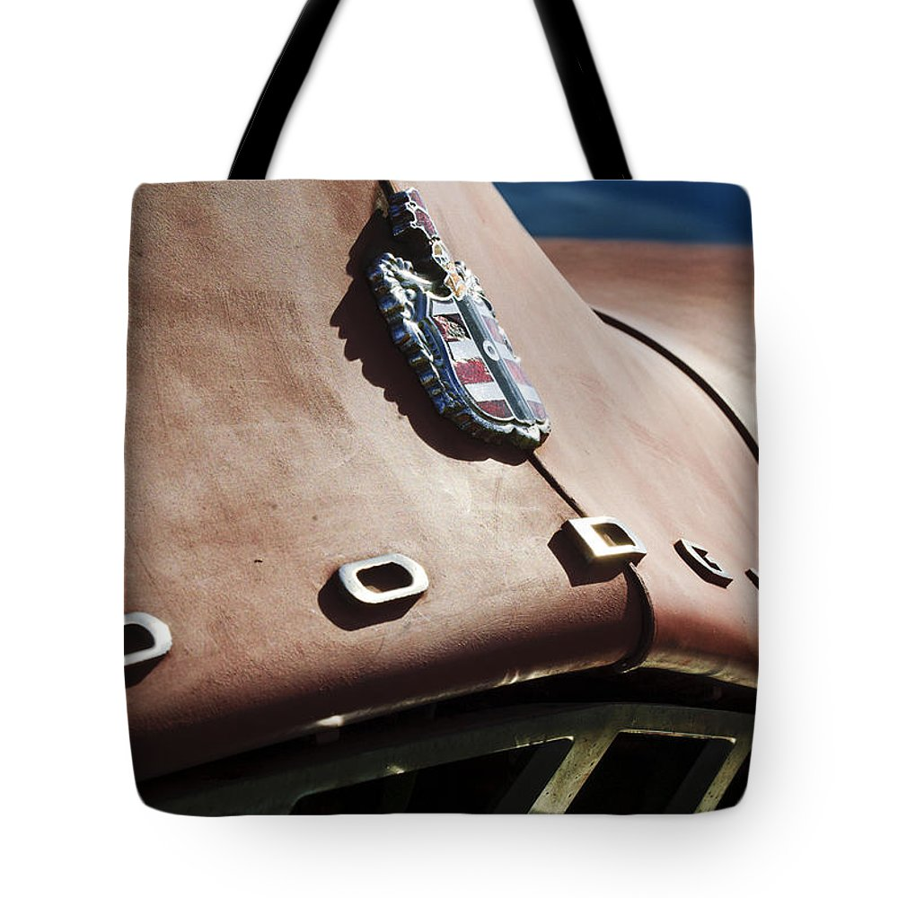 1952 Dodge Tote Bag featuring the photograph 1952 Dodge Hood Emblem by Jill Reger