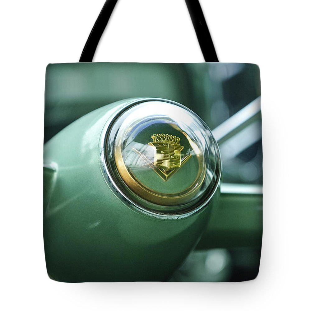 1955 Cadillac Coupe Deville Steering Wheel Emblem Tote Bag For Sale Featuring The Photograph