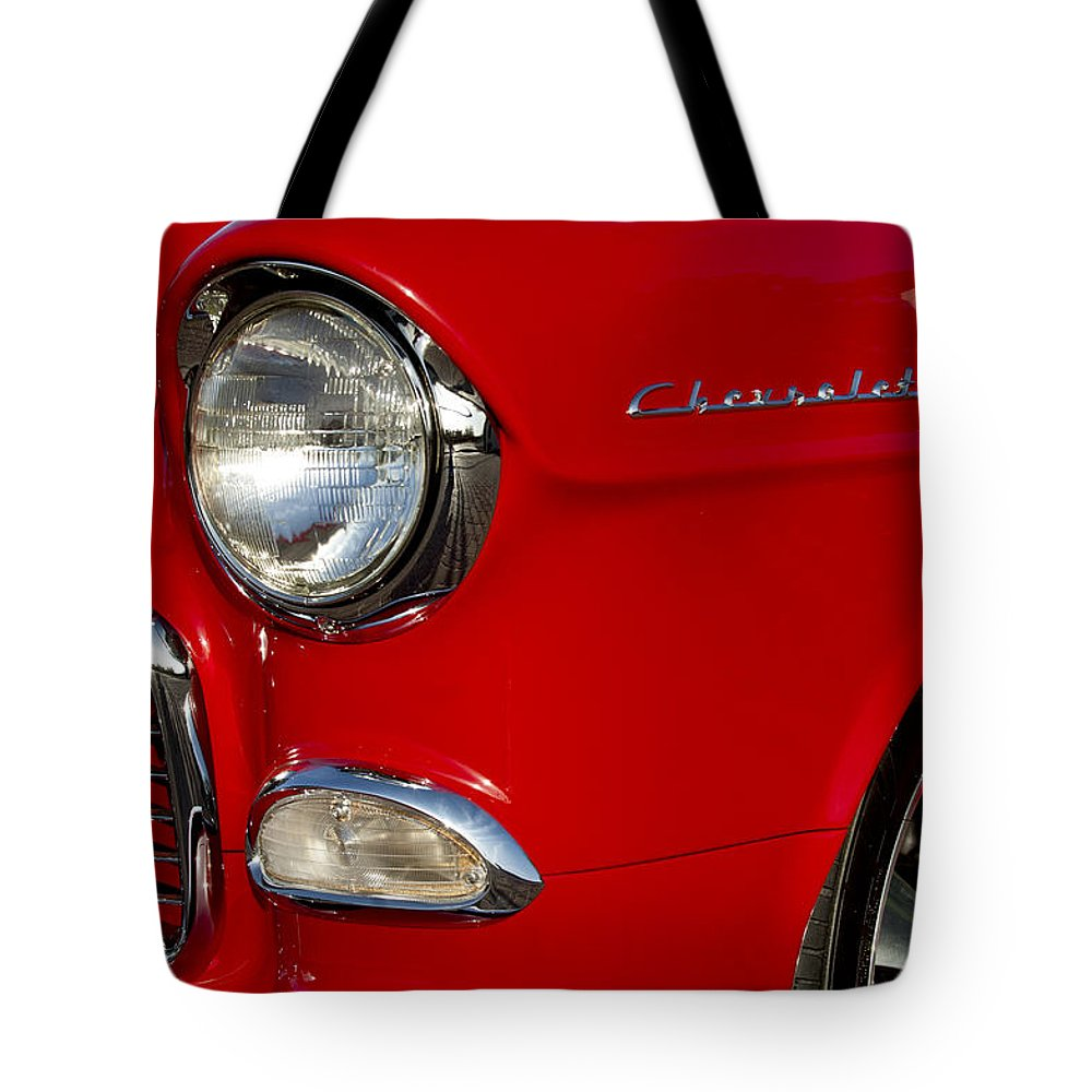 1955 Chevrolet 210 Tote Bag featuring the photograph 1955 Chevrolet 210 Headlight by Jill Reger