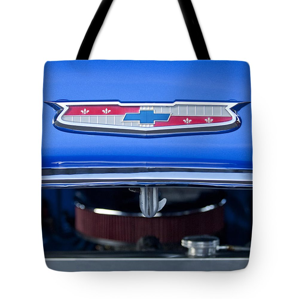 1955 Chevrolet Belair Tote Bag featuring the photograph 1955 Chevrolet Belair Hood Emblem 4 by Jill Reger