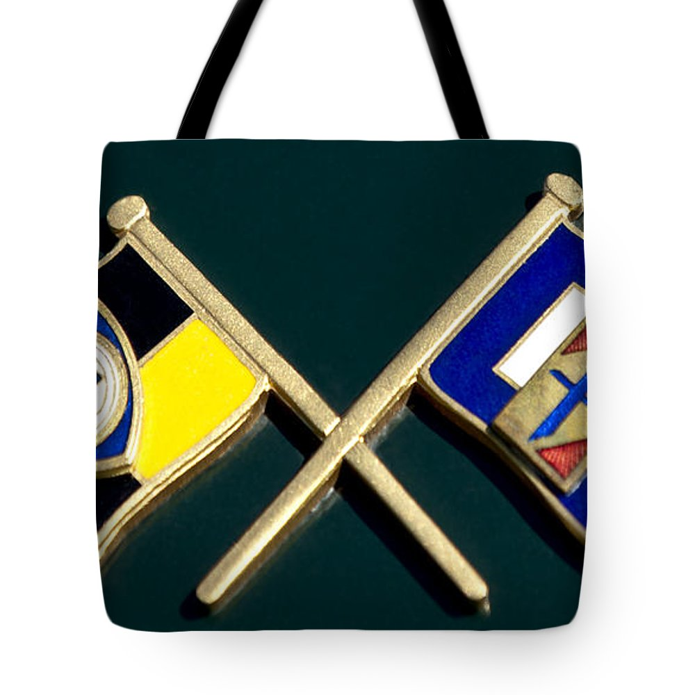 1955 Lancia Tote Bag featuring the photograph 1955 Lancia Emblem by Jill Reger
