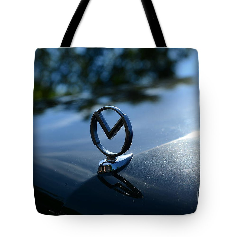1958 Mercury Park Lane Hood Ornament Tote Bag featuring the photograph 1958 Mercury Park Lane Hood Ornament by Paul Ward