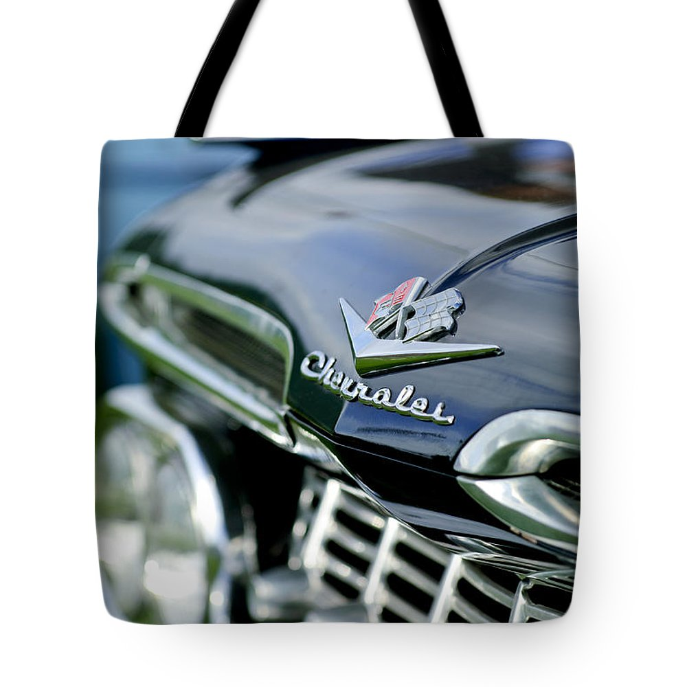 1959 Chevrolet Tote Bag featuring the photograph 1959 Chevrolet Grille Emblem by Jill Reger