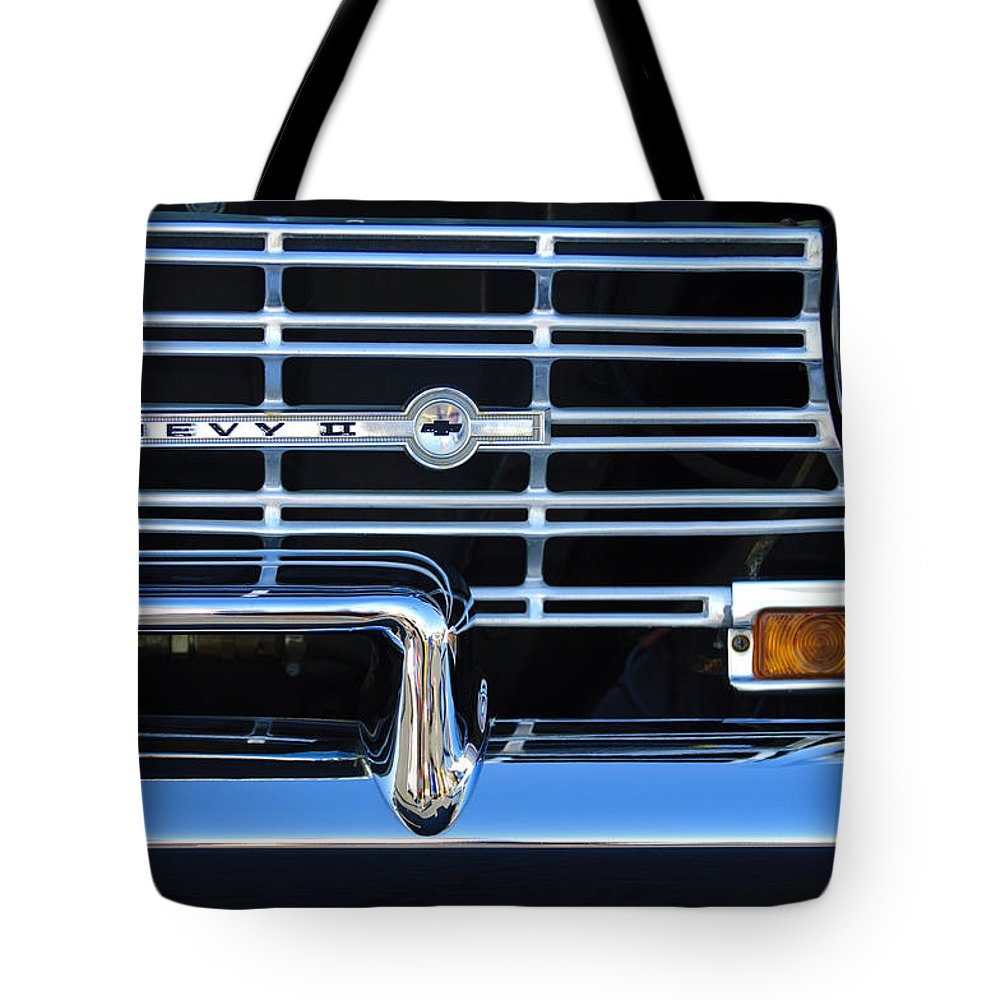 1962 Chevrolet Nova Tote Bag featuring the photograph 1962 Chevrolet Nova Grille Emblem by Jill Reger