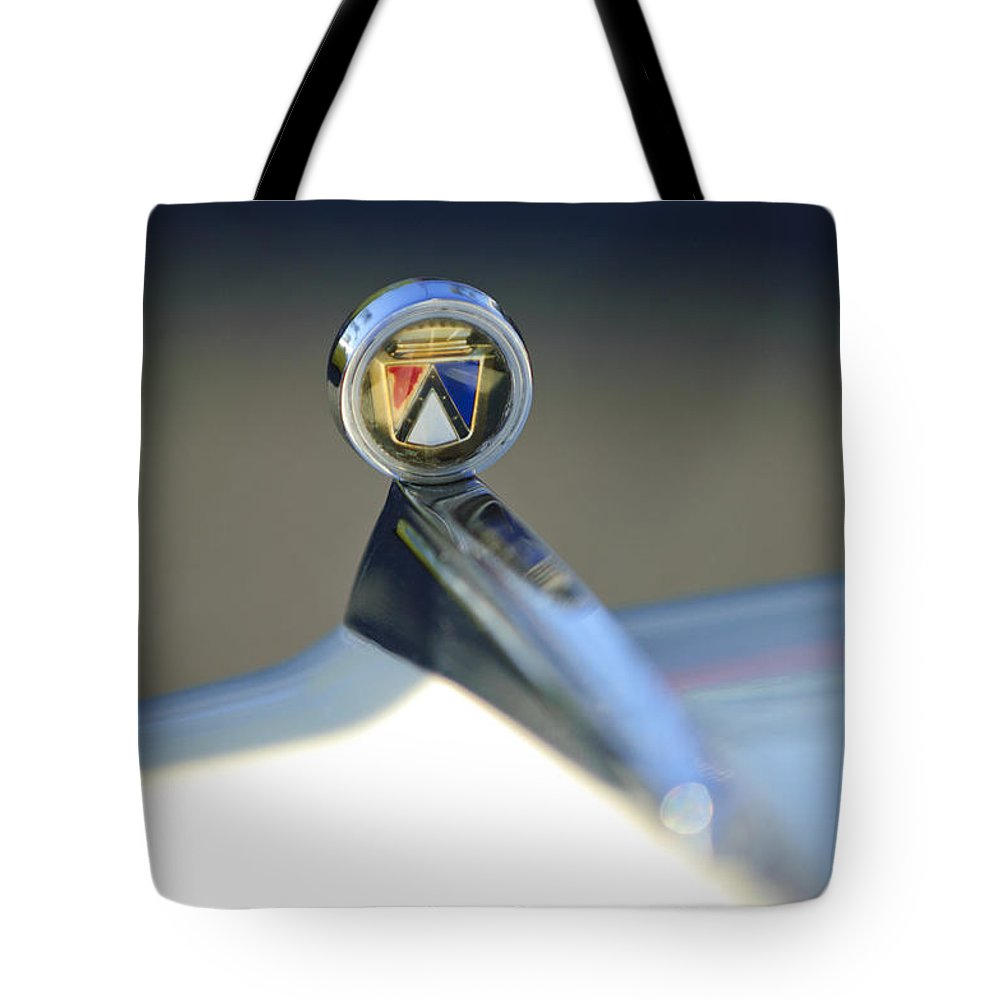 1963 Ford Futura Tote Bag featuring the photograph 1963 Ford Futura Hood Ornament by Jill Reger
