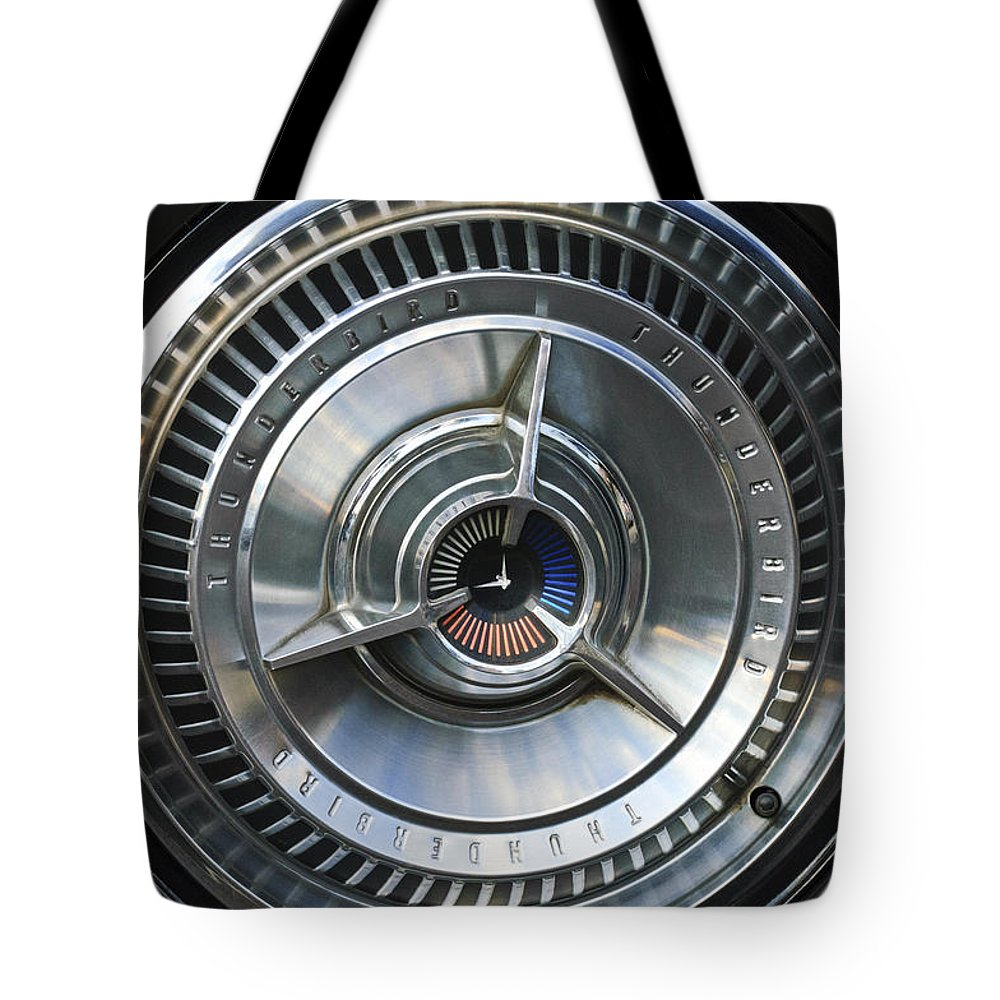 1964 Ford Thunderbird Tote Bag featuring the photograph 1964 Ford Thunderbird Wheel Rim by Jill Reger