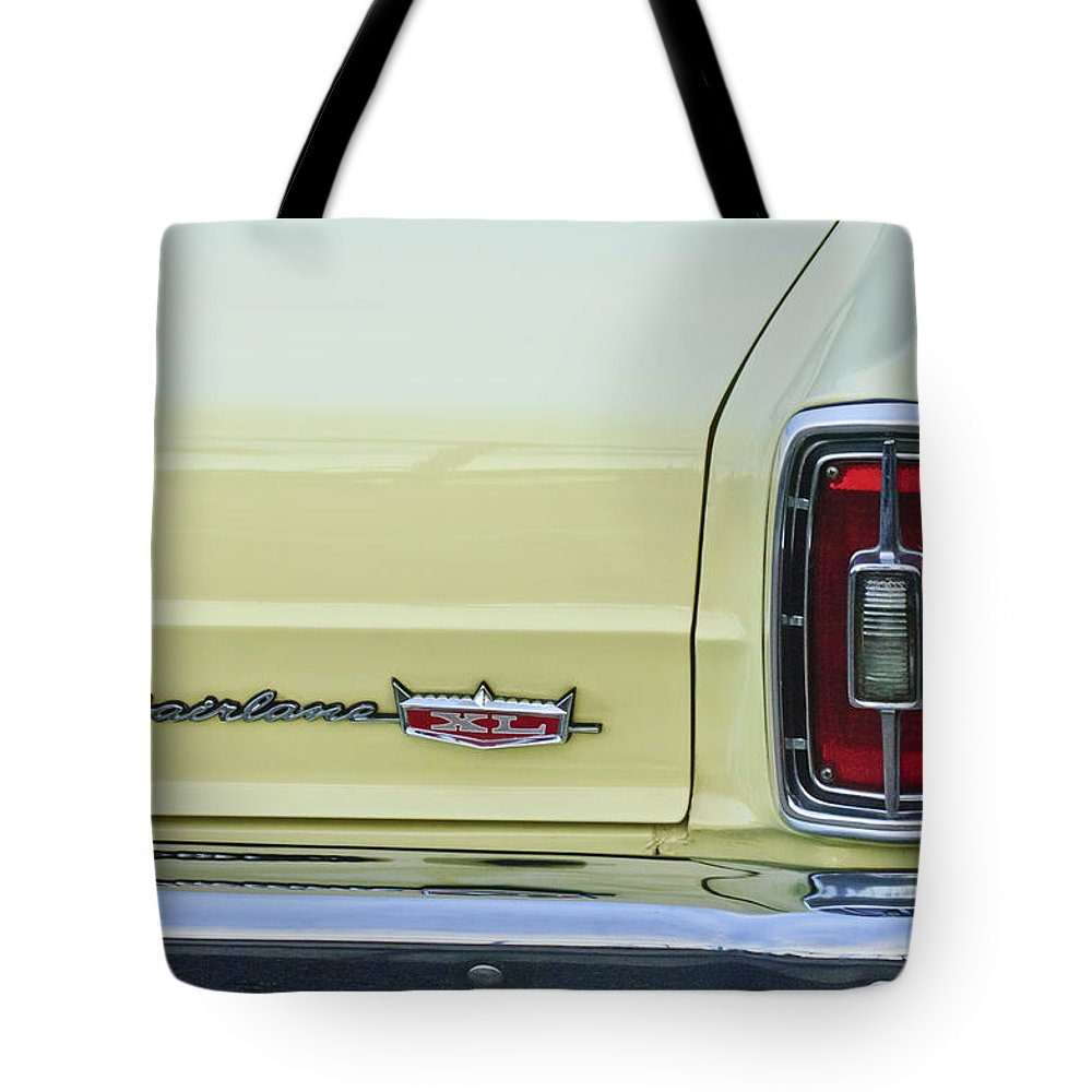 1966 Ford Fairlane Xl Tote Bag featuring the photograph 1966 Ford Fairlane Xl Taillight Emblem by Jill Reger