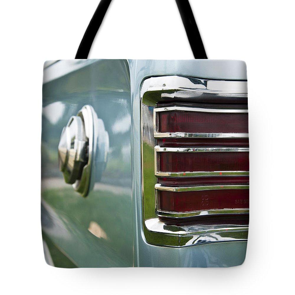 1966 Plymouth Satellite Tail Light Tote Bag featuring the photograph 1966 Plymouth Satellite Tail Light by Glenn Gordon