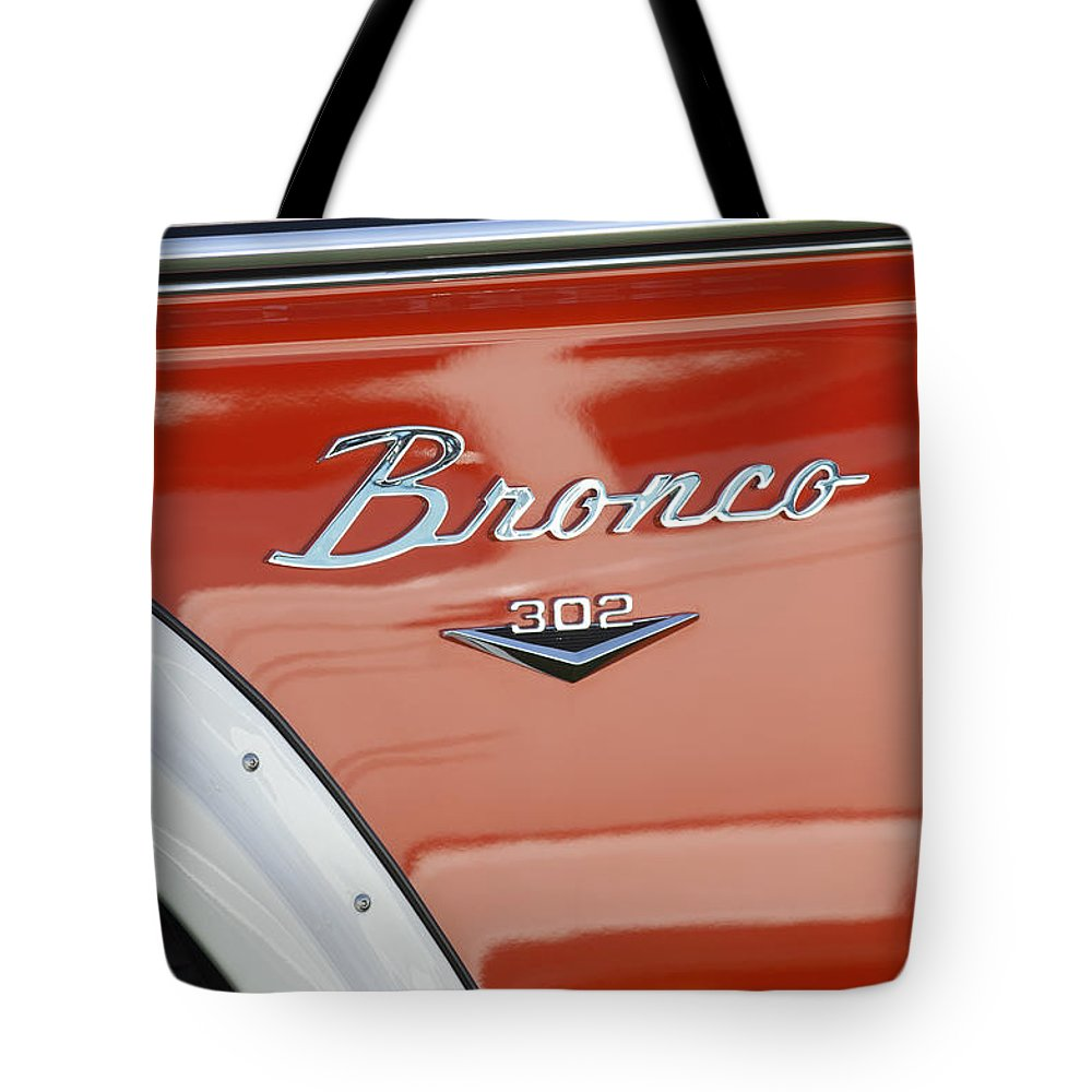 1972 Bronco Tote Bag featuring the photograph 1972 Bronco Emblem by Jill Reger