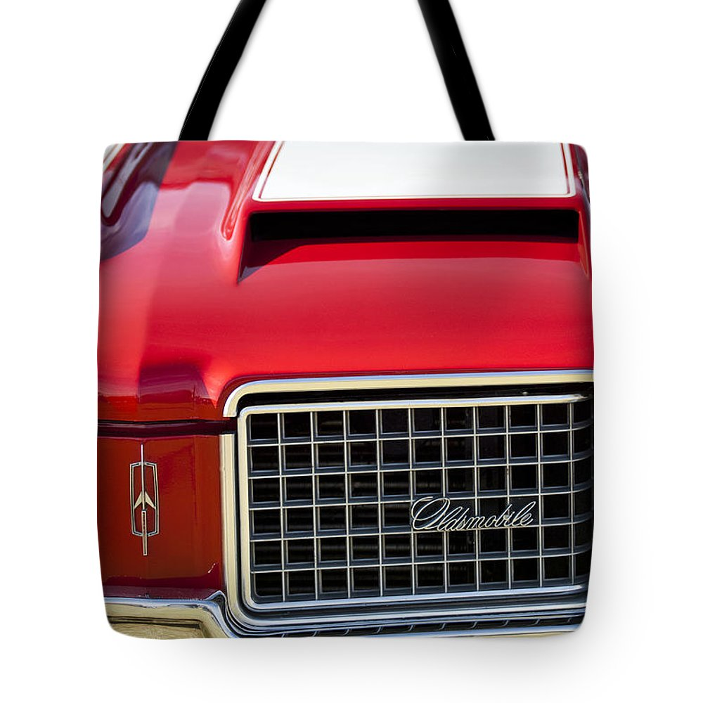 1972 Oldsmobile Tote Bag featuring the photograph 1972 Oldsmobile Grille by Jill Reger
