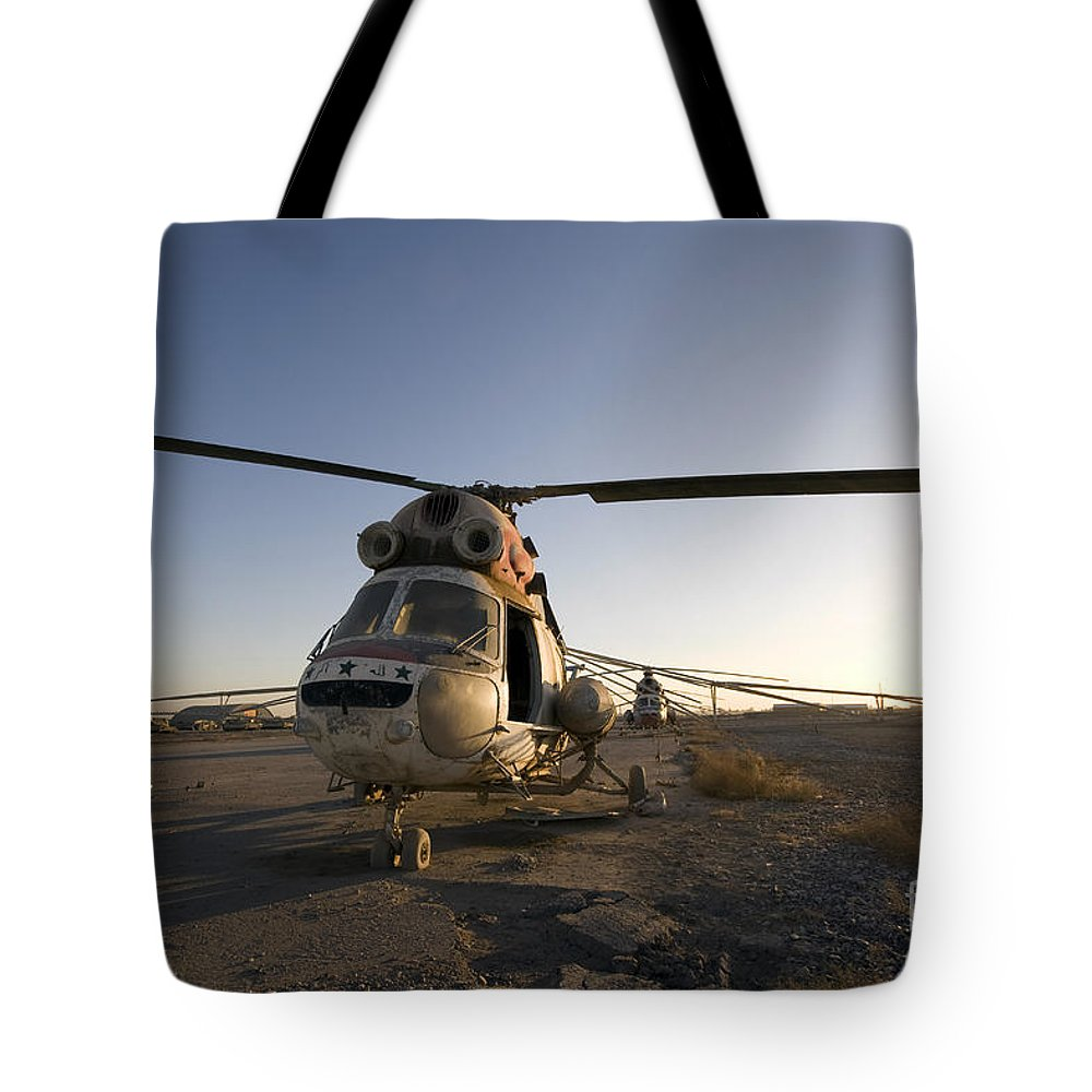 Aviation Tote Bag featuring the photograph An Iraqi Helicopter Sits On The Flight by Terry Moore