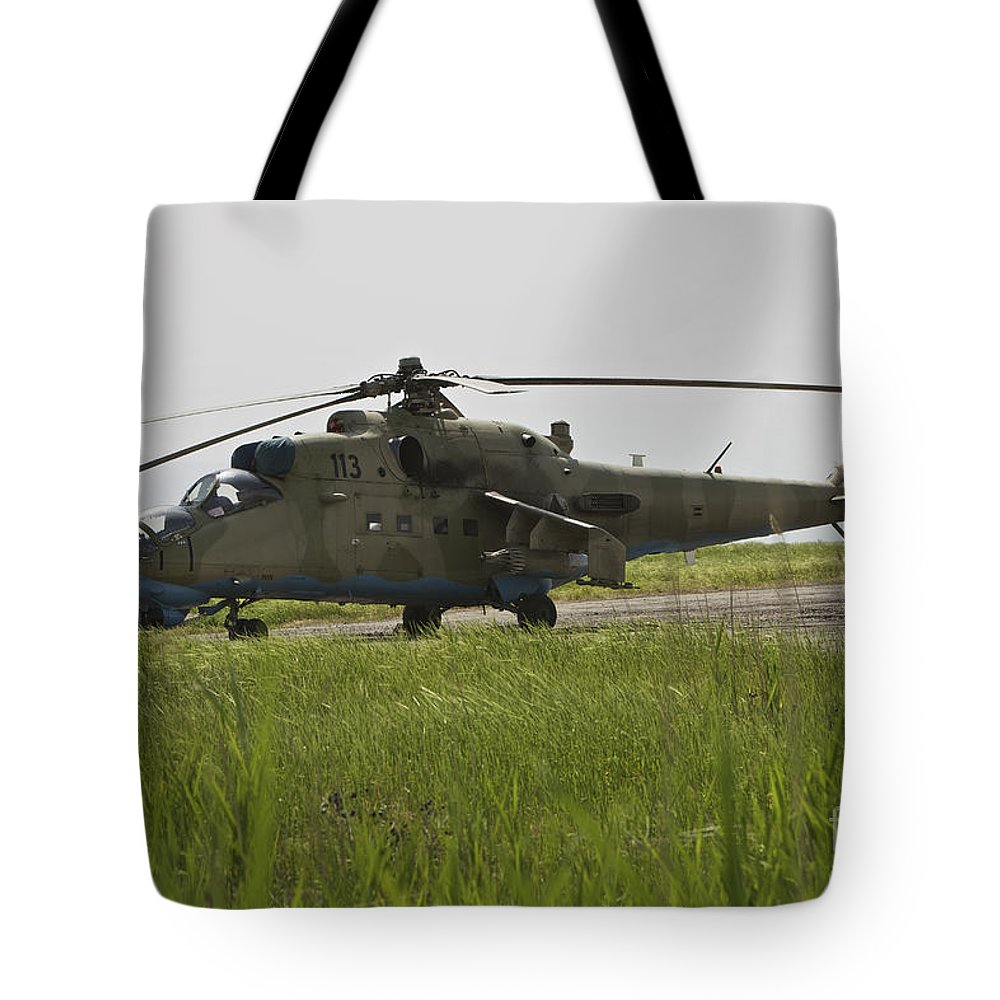 Airfield Tote Bag featuring the photograph An Mi-35 Attack Helicopter At Kunduz by Terry Moore