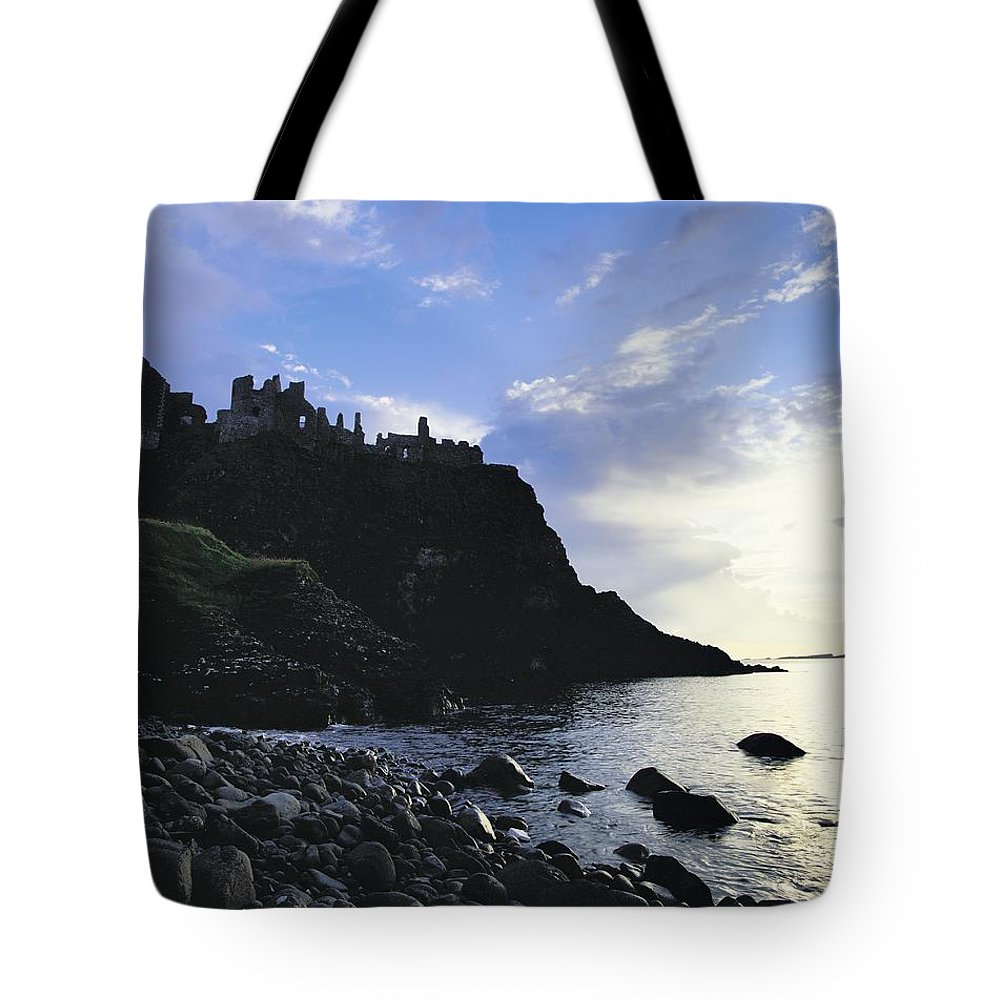 Antrim Tote Bag featuring the photograph Dunluce Castle, Co Antrim, Ireland by The Irish Image Collection