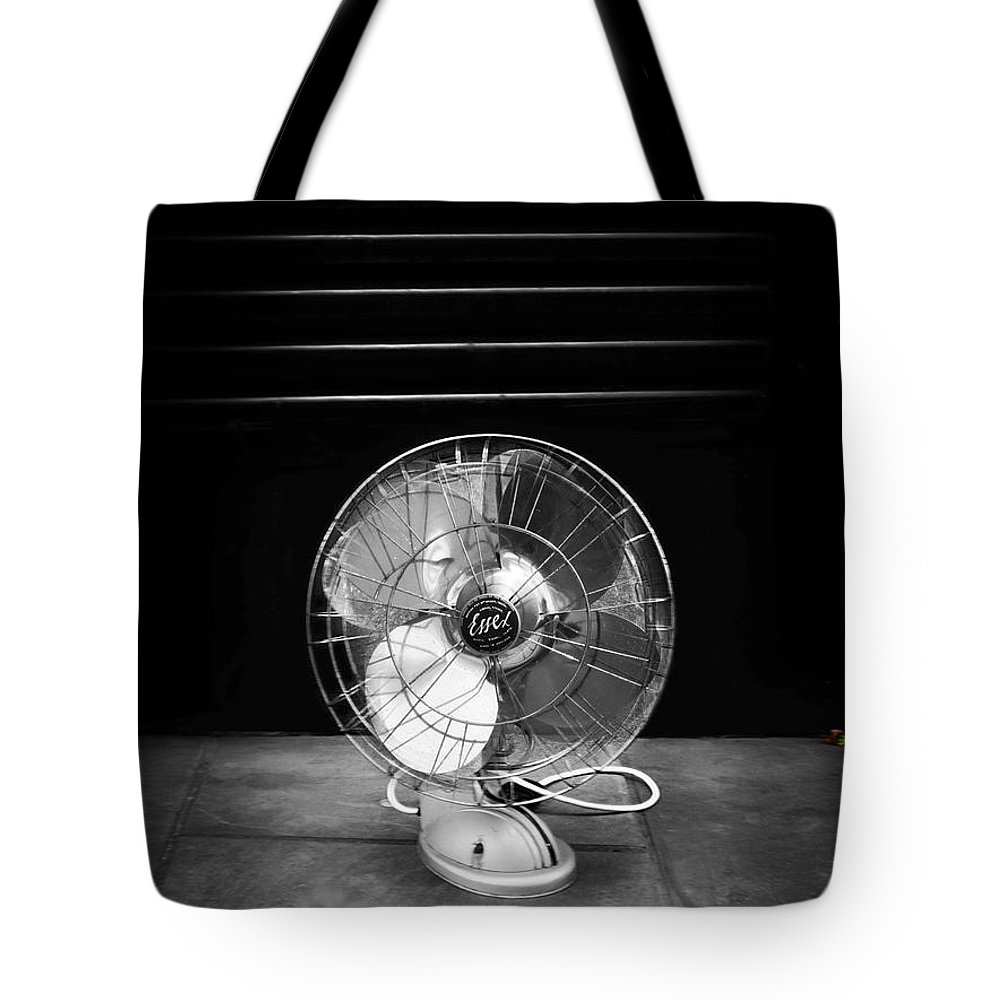 Fan Tote Bag featuring the photograph Harvest by Charles Stuart