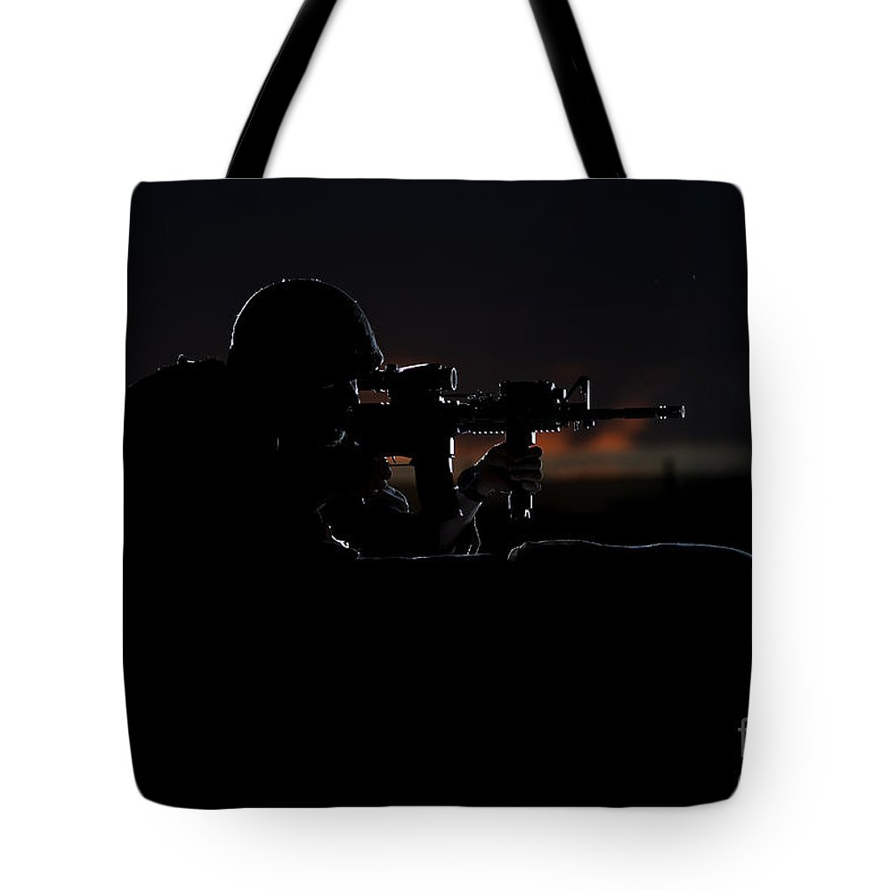 Afghanistan Tote Bag featuring the photograph Partially Silhouetted U.s. Marine by Terry Moore