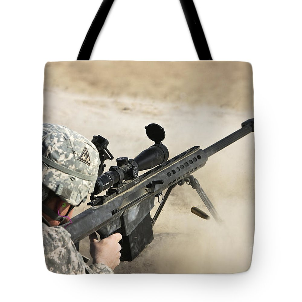 Sniper Tote Bag featuring the photograph U.s. Army Soldier Fires A Barrett M82a1 by Terry Moore