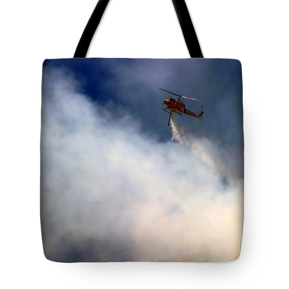 Ash Tote Bag featuring the photograph Barnett Fire by Henrik Lehnerer