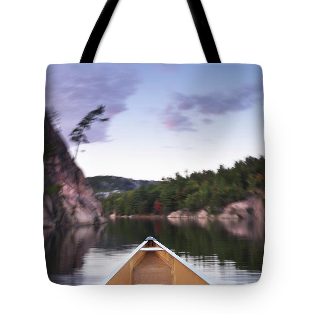 Canoe Tote Bag featuring the photograph Canoeing In Ontario Provincial Park by Oleksiy Maksymenko