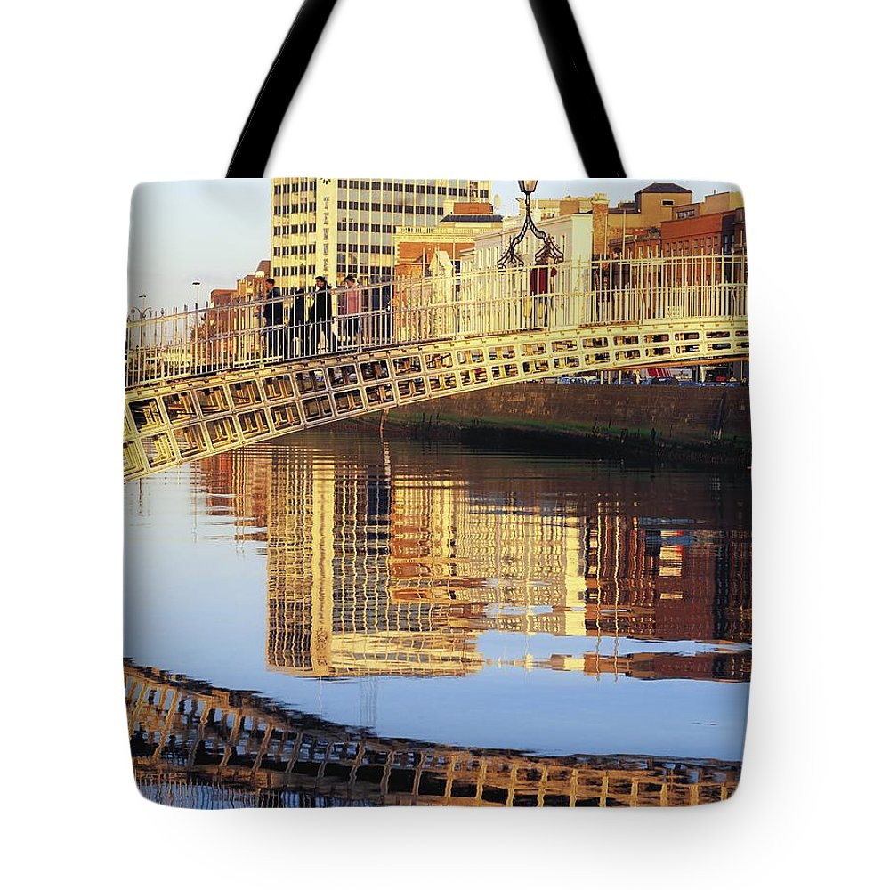Background People Tote Bag featuring the photograph Hapenny Bridge, River Liffey, Dublin by The Irish Image Collection