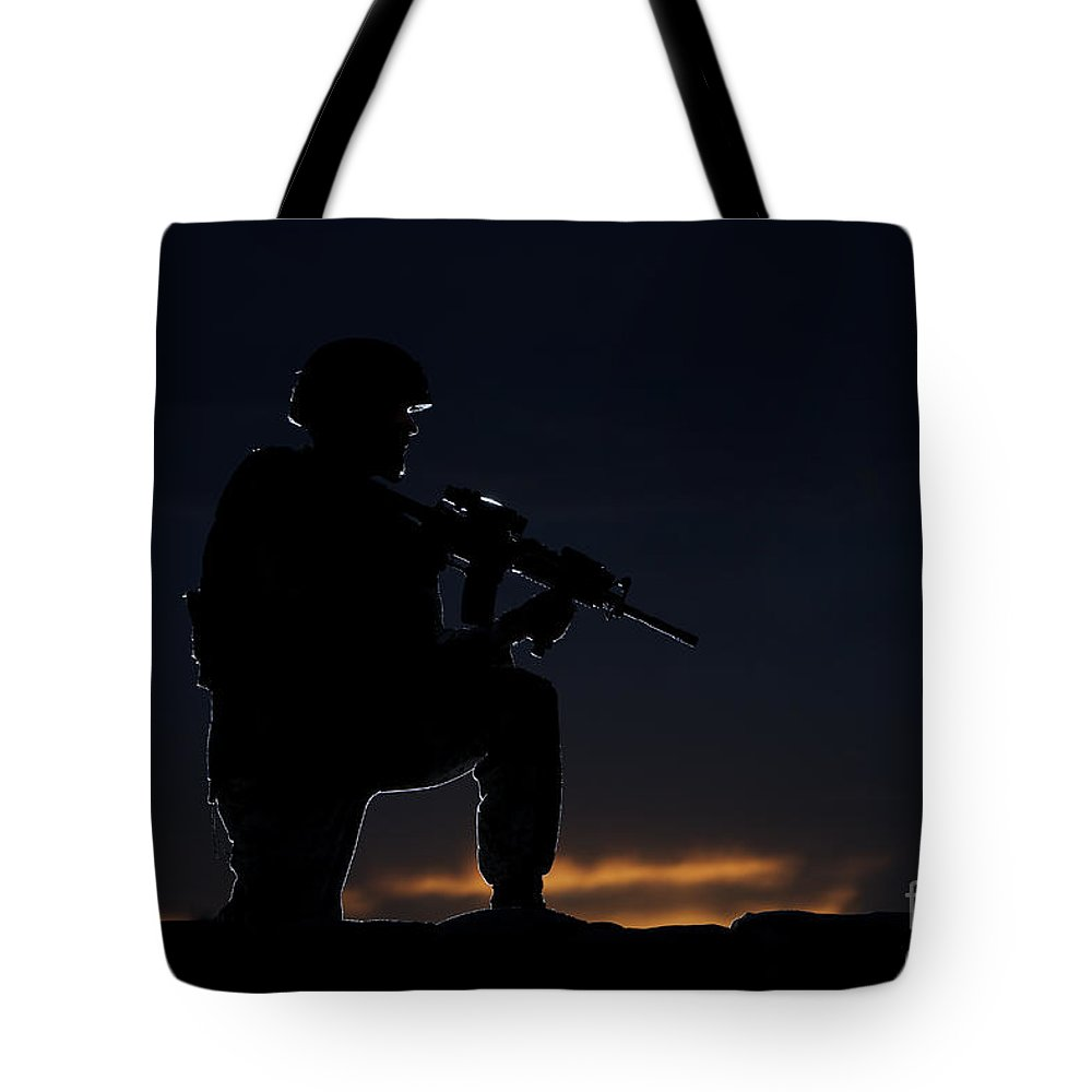 Outdoors Tote Bag featuring the photograph Partially Silhouetted U.s. Marine by Terry Moore