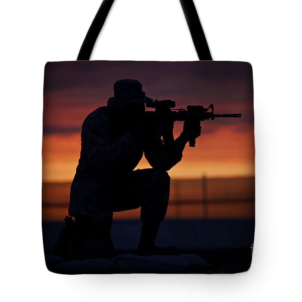 M16 Tote Bag featuring the photograph Silhouette Of A U.s Marine On A Bunker by Terry Moore
