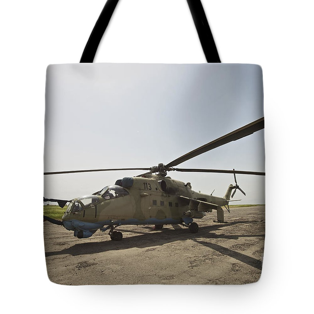 Kunduz Tote Bag featuring the photograph An Mi-35 Attack Helicopter At Kunduz by Terry Moore