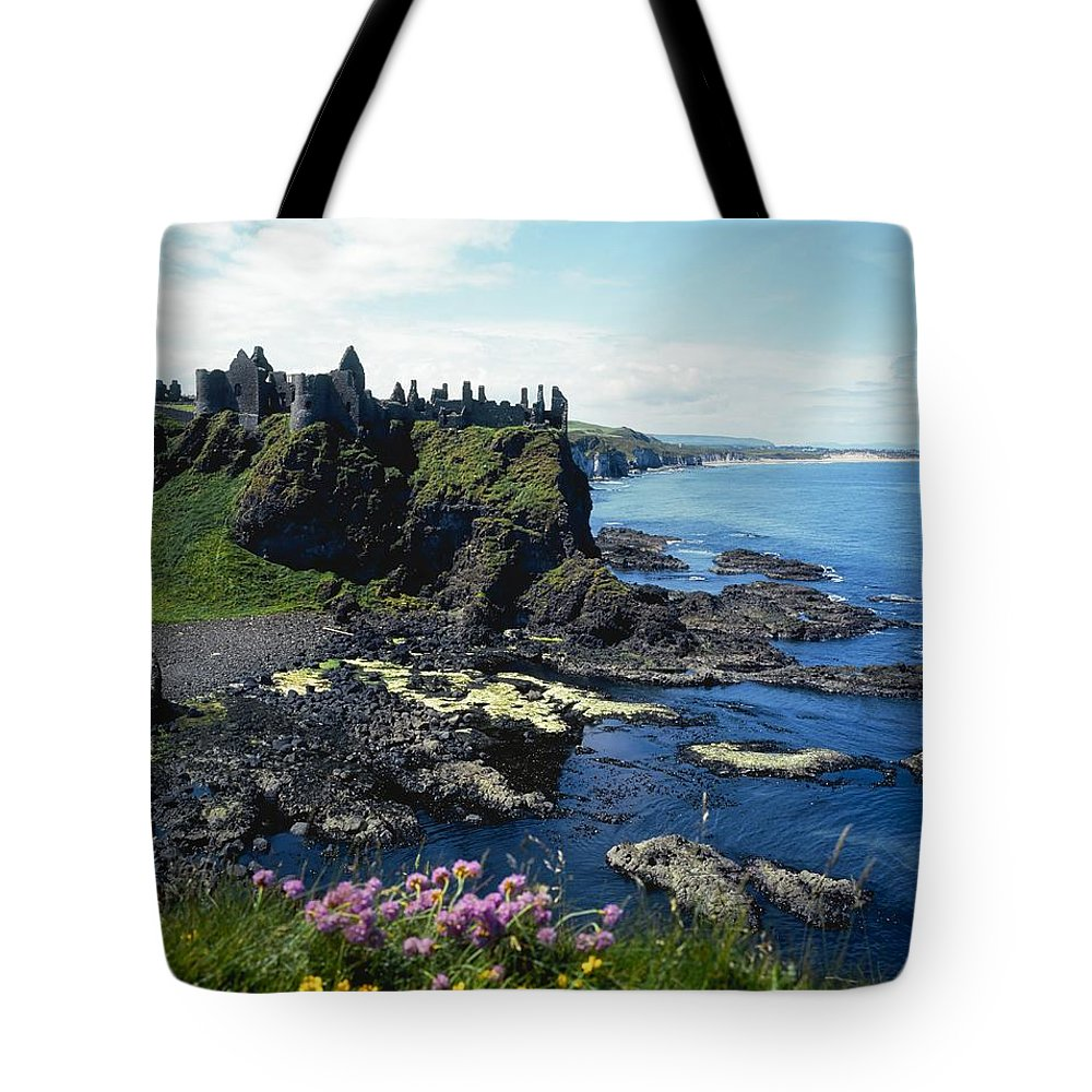 Archeological Site Tote Bag featuring the photograph Dunluce Castle, Co Antrim, Ireland by The Irish Image Collection
