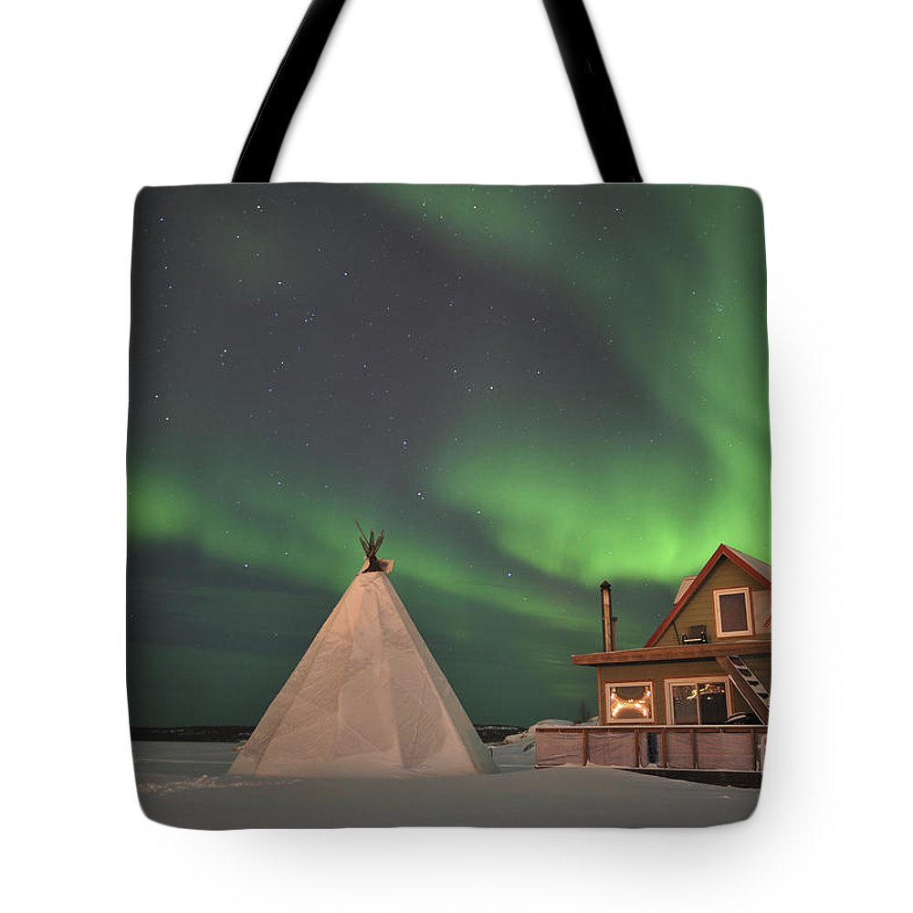 Yellowknife Tote Bag featuring the photograph Northern Lights Above Village by Jiri Hermann