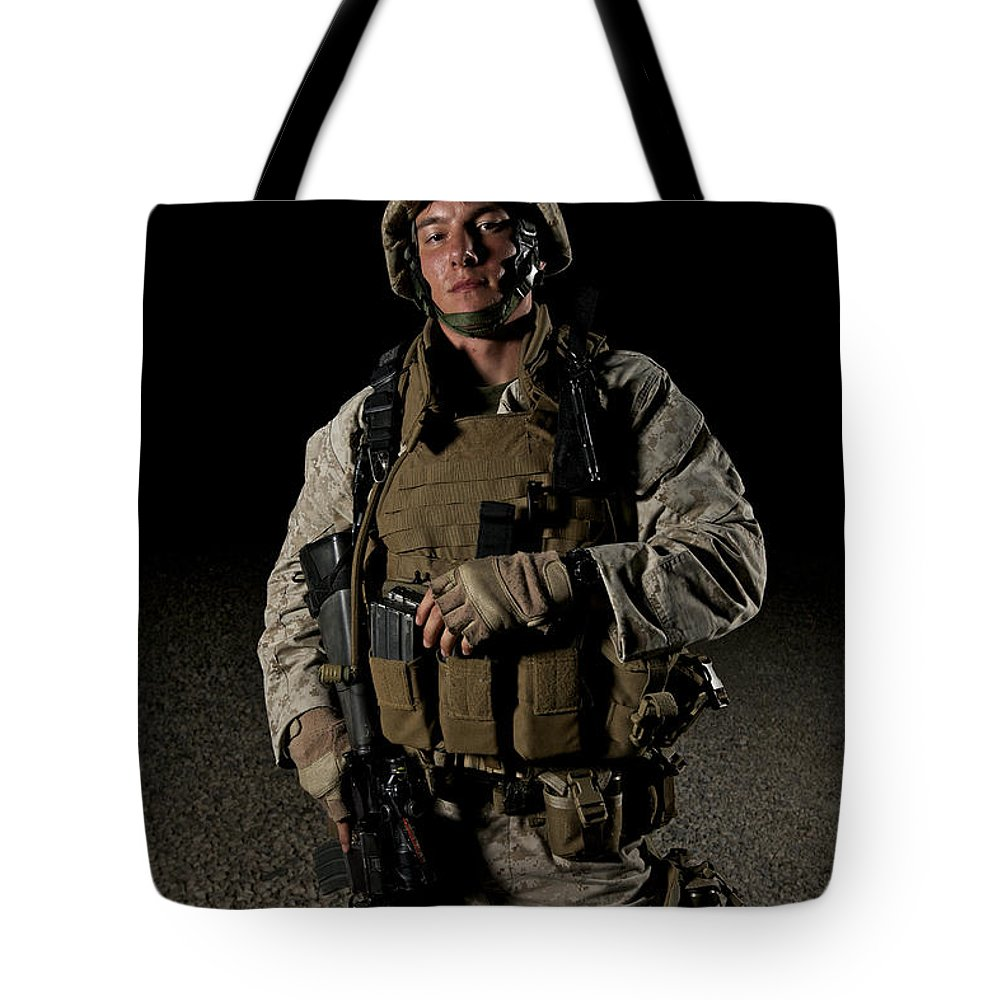 Helmet Tote Bag featuring the photograph Portrait Of A U.s. Marine by Terry Moore