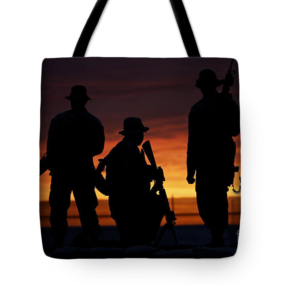 M16 Tote Bag featuring the photograph Silhouette Of U.s Marines On A Bunker by Terry Moore