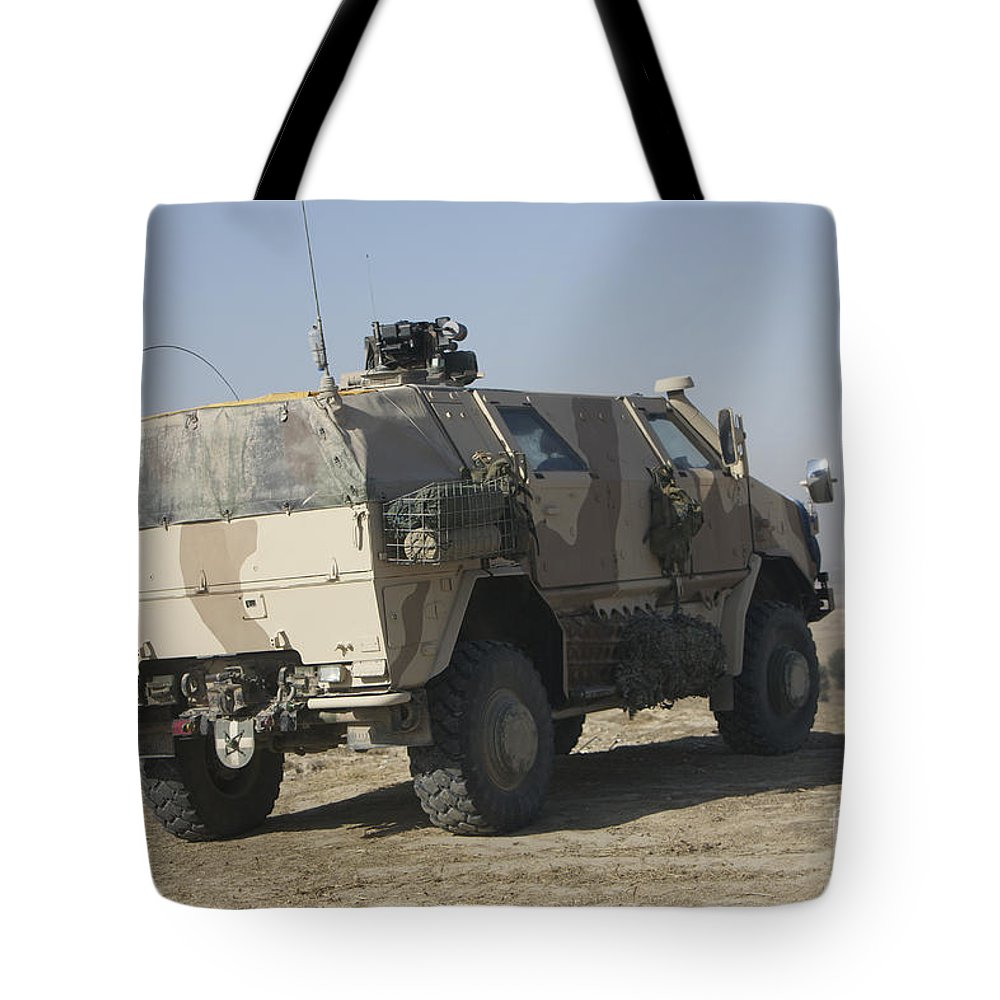 German Army Tote Bag featuring the photograph The German Army Atf Dingo Armored by Terry Moore