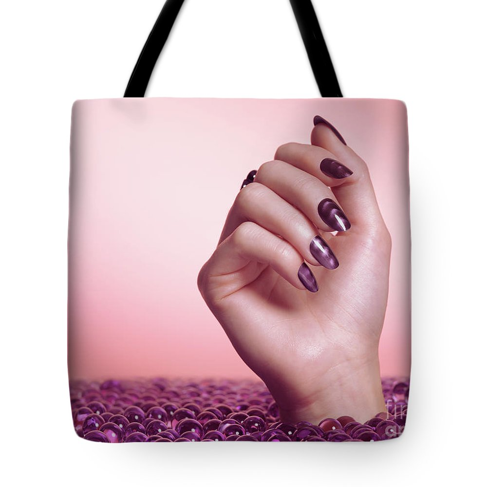 Manicure Tote Bag featuring the photograph Woman Hand With Purple Nail Polish by Oleksiy Maksymenko