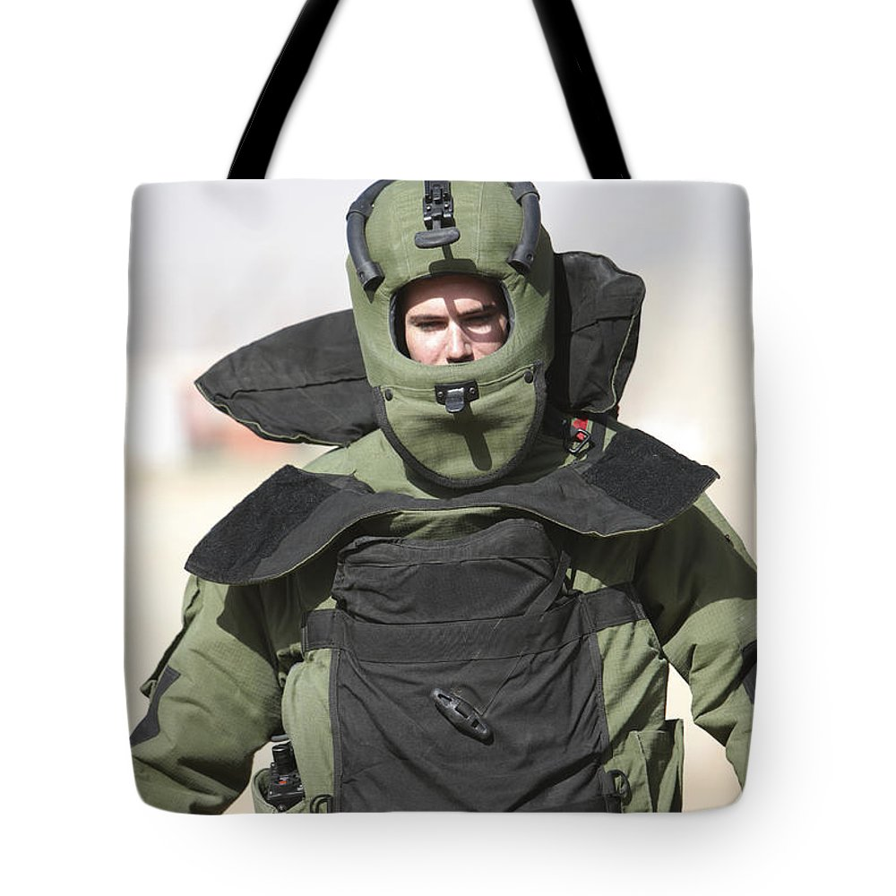Operation Enduring Freedom Tote Bag featuring the photograph A U.s. Marine Gets Suited by Terry Moore