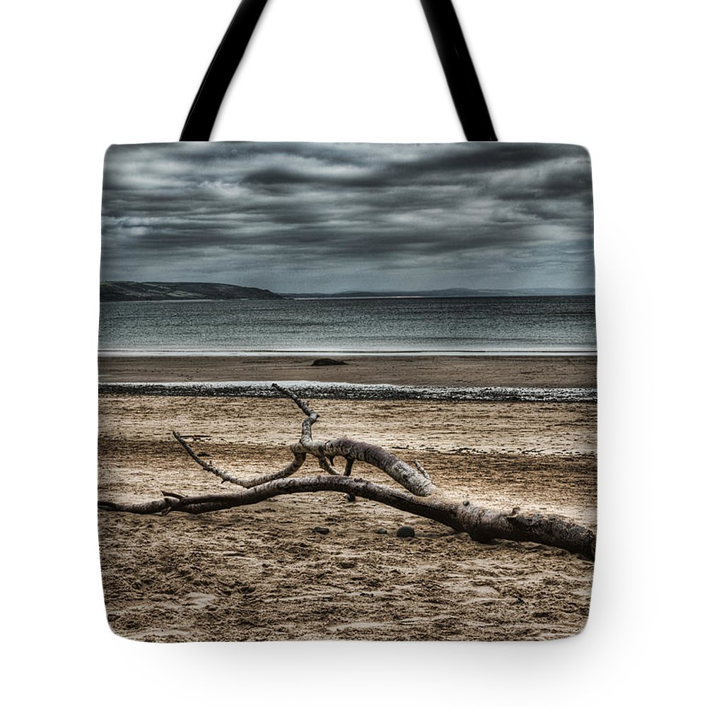 Driftwood Tote Bag featuring the photograph Driftwood by Steve Purnell
