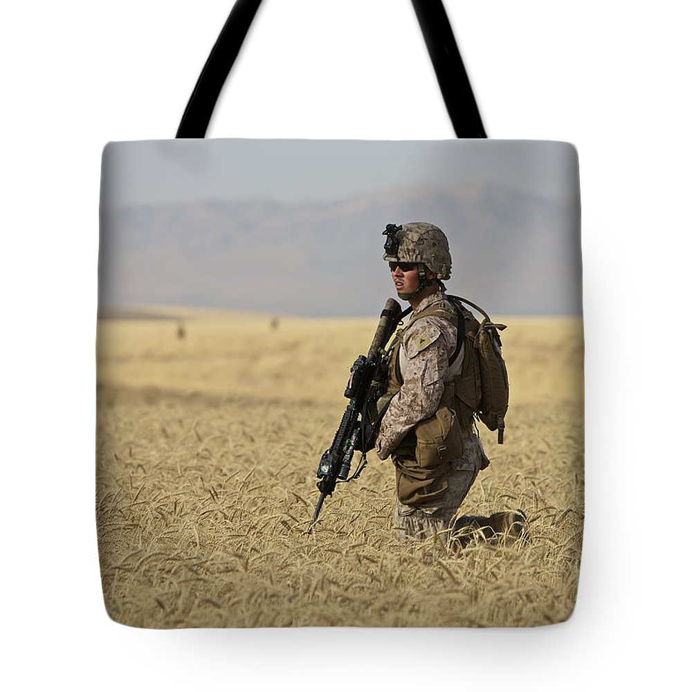 Afghanistan Tote Bag featuring the photograph U.s. Marine Patrols A Wadi Near Kunduz by Terry Moore
