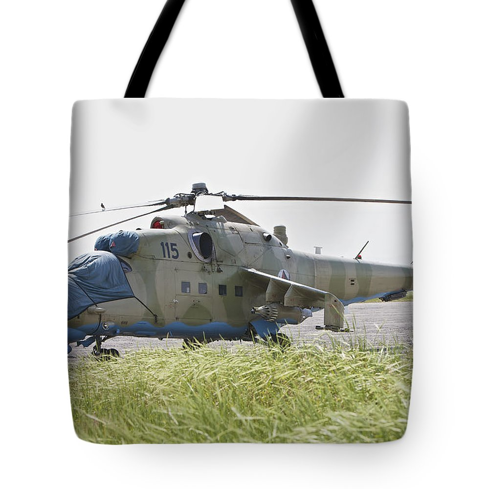Rotary Wing Aircraft Tote Bag featuring the photograph An Mi-35 Attack Helicopter At Kunduz by Terry Moore