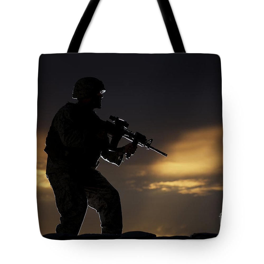 Vigilant Tote Bag featuring the photograph Partially Silhouetted U.s. Marine by Terry Moore