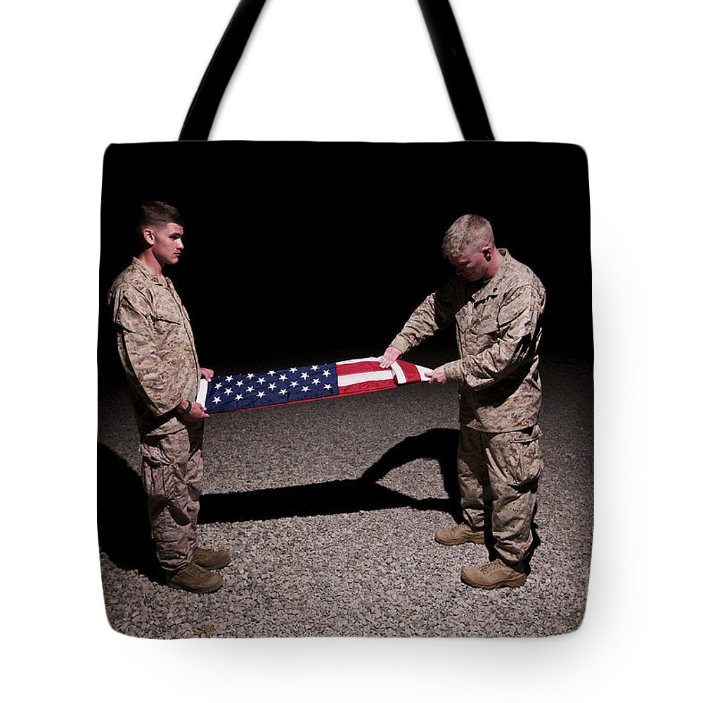 Night Tote Bag featuring the photograph U.s. Marines Fold The American Flag by Terry Moore