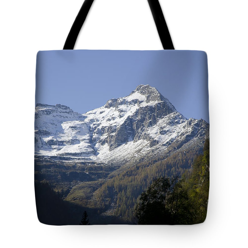 Mountain Tote Bag featuring the photograph Snow-capped Mountain by Mats Silvan