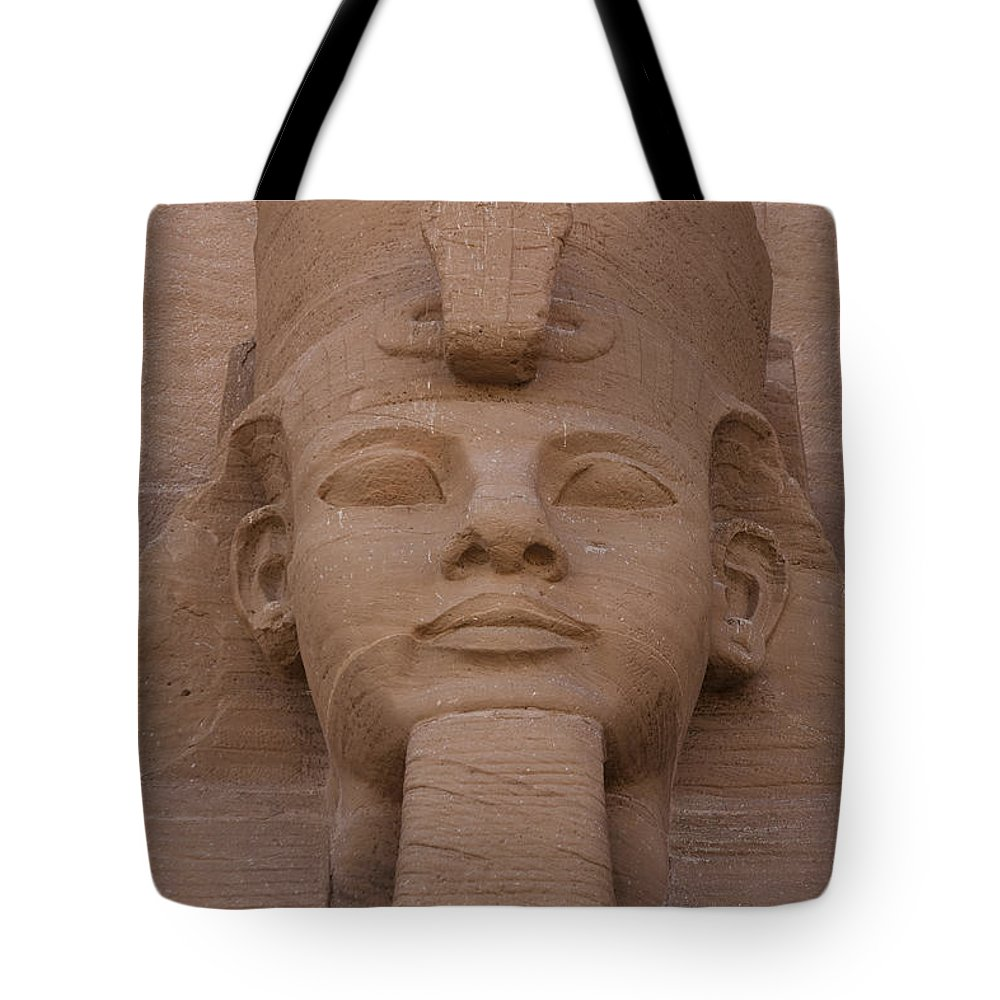 Abu Simbel Tote Bag featuring the photograph A Close View Of The Face Of Ramses IIs by Taylor S. Kennedy