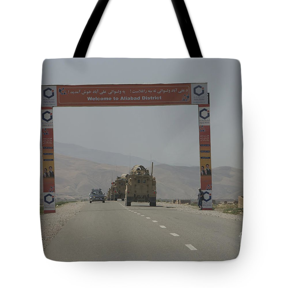 Afghanistan Tote Bag featuring the photograph A Convoy Of Cougar Mraps Driving by Terry Moore