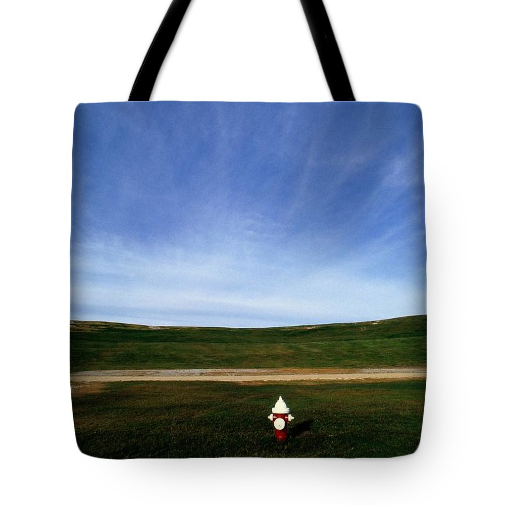 Virginia Beach Tote Bag featuring the photograph A Fire Hydrant In A Green Field by Raymond Gehman