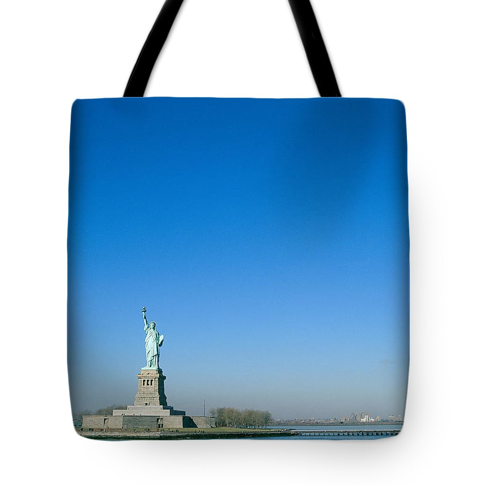 Statue Of Liberty National Monument Tote Bag featuring the photograph A Frontal View Of The Statue Of Liberty by Norbert Rosing
