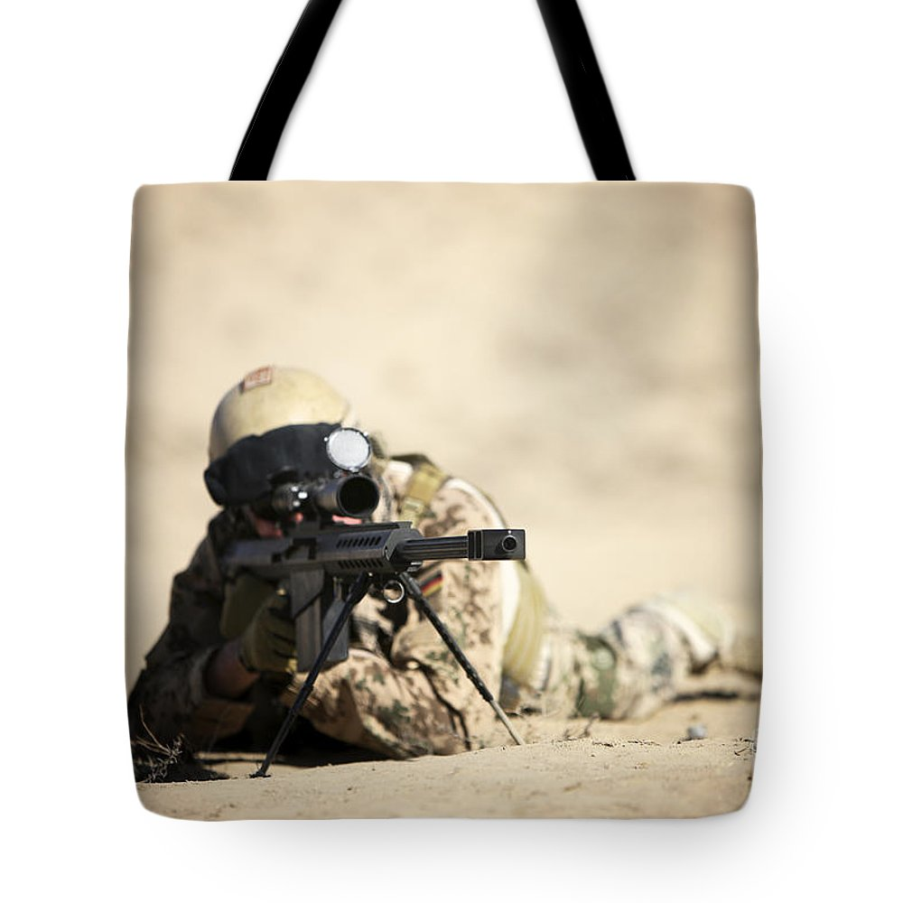 Army Tote Bag featuring the photograph A German Soldier Sights In A Barrett by Terry Moore