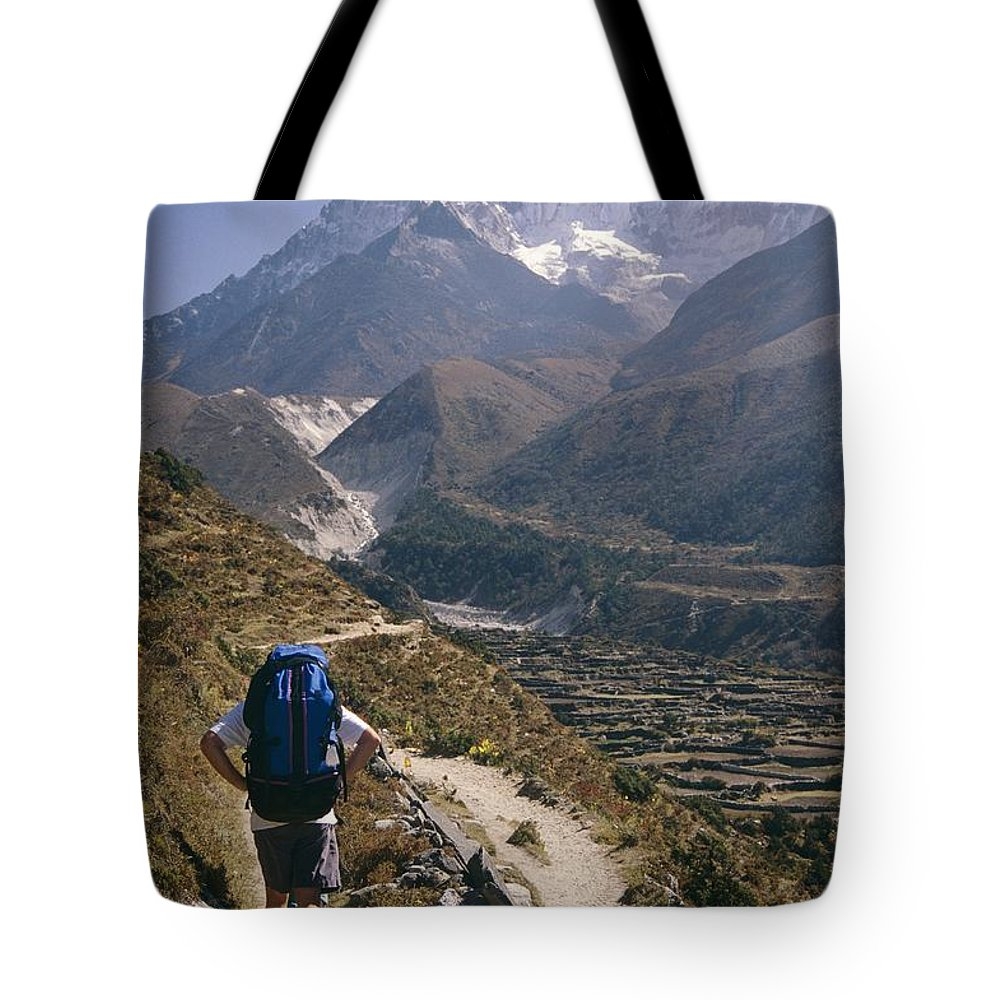 Tote Bag featuring the photograph A Hiker With A Mountain Range by Michael Klesius